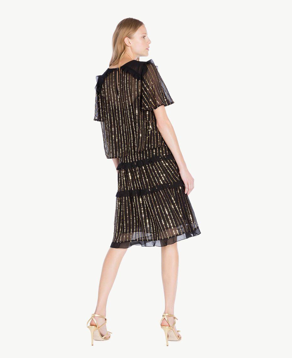 Kleid und Bluse mit Pailletten Schwarz Frau TS82WP-03