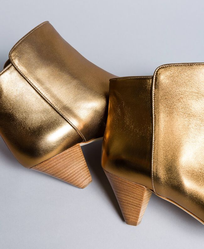 Laminated leather ankle boots Gold Yellow Woman CA8TPA-04