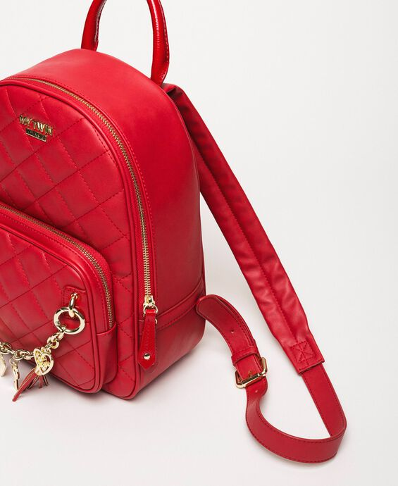 Quilted faux leather backpack with charms