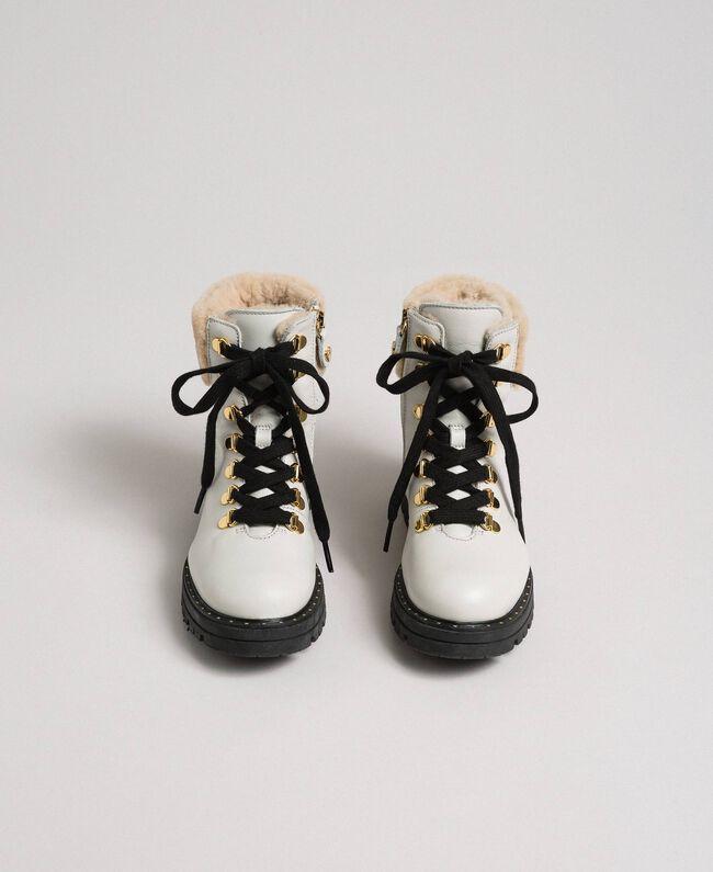 Stiefelette aus Leder mit Wanderschuhschnürung Chantily Kind 192GCJ01C-04