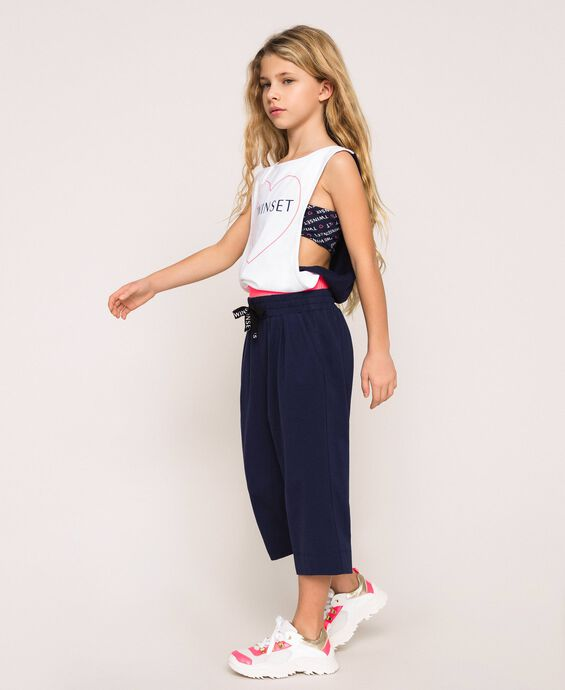 Cropped trousers with logo