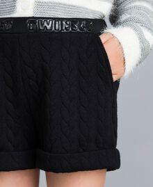 Shorts aus Sweatstoff mit Steppmotiv Schwarz Kind GA82NQ-04