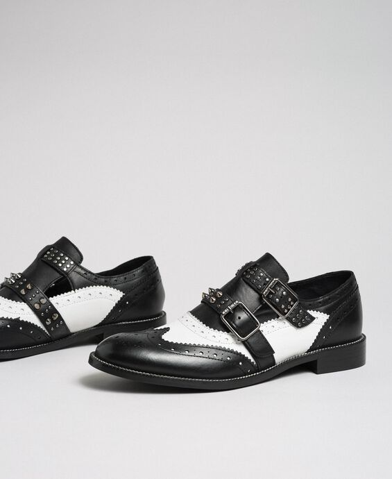 Leather shoes with tie up laces and studded straps