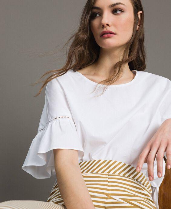 Blusa in popeline con balza