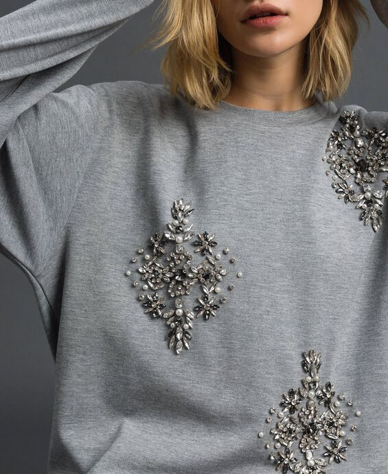 Sweatshirt with stone and pearl embroidery