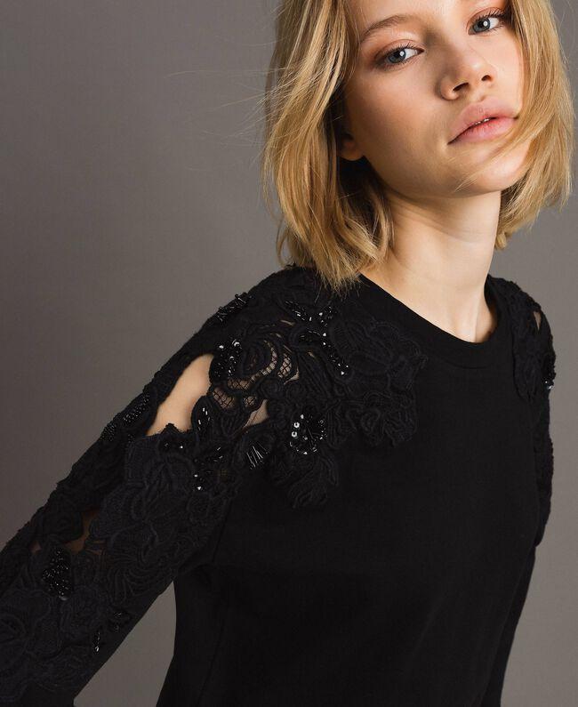 Sweatshirt mit Blumenstickapplikationen Schwarz Frau 191TT2210-04