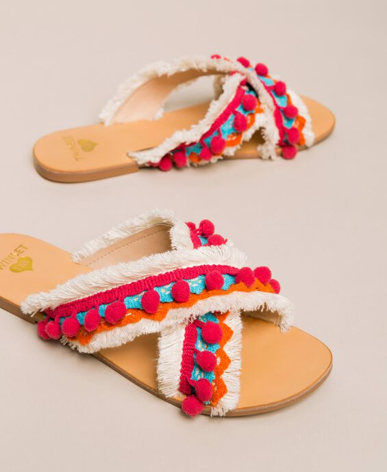 Weaved slippers with pompom and fringe