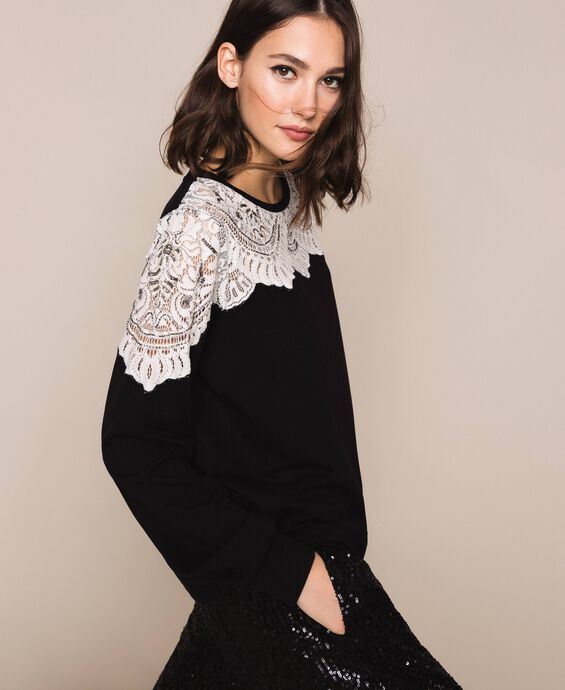 Sweatshirt with lace inlay and embroidery