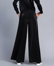Technical fabric palazzo trousers Black Woman IA85CC-03