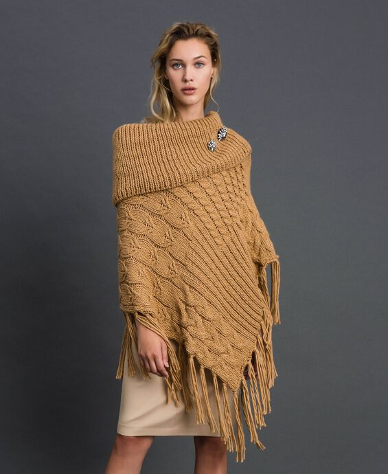 Knit poncho with fringes and bezels