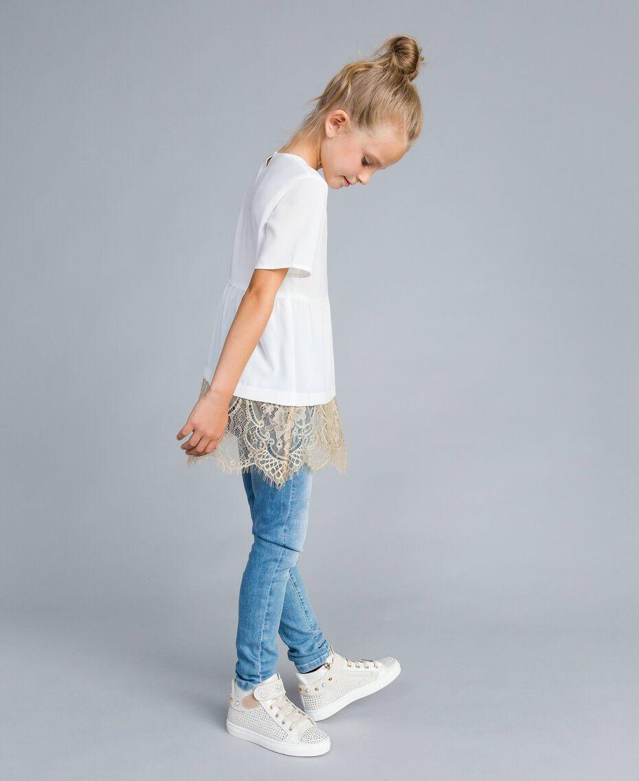 Jeans skinny con pietre e strass Denim Chiaro Bambina GA82VN-02