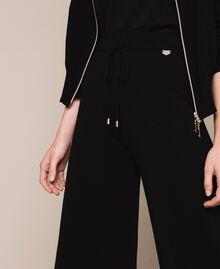 Pantaloni in maglia con pizzo Nero Donna 201LL3GBB-05