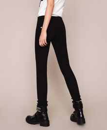 Skinny trousers with frayed hem Black Woman 201MP2301-03