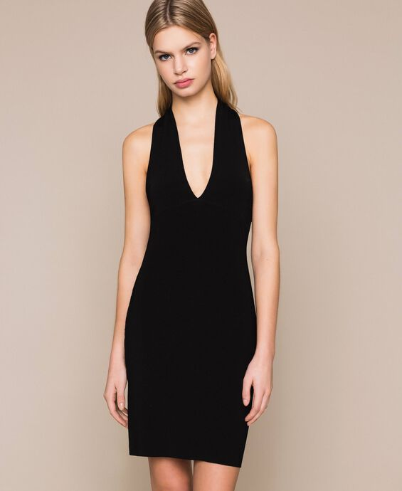 Sheath dress with crossover bands and cut outs