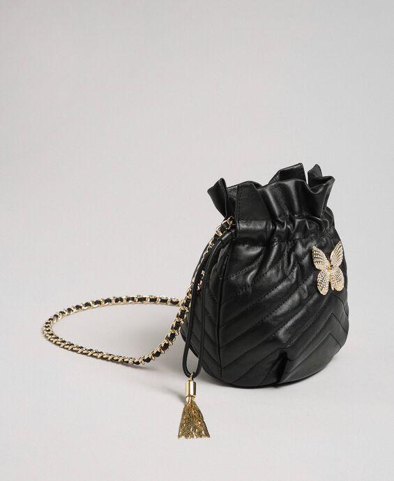 Маленькая сумка-мешок из стеганой кожи