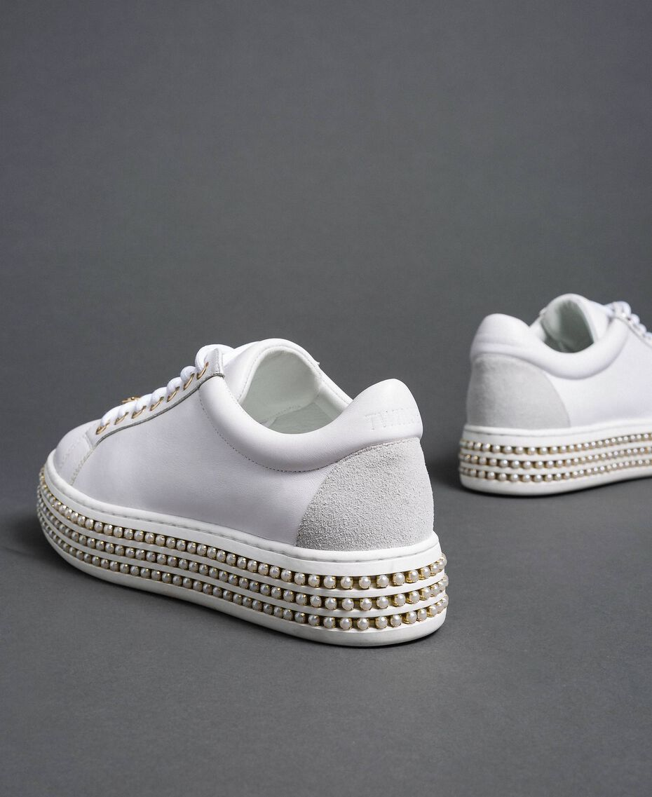 Platform sole trainers with pearls White Woman 192TCP06J-02