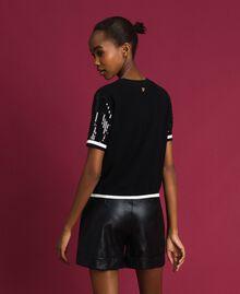 Cropped-Pullover mit aufgestickten Pailletten Zweifarbig Schwarz / Lilie Frau 192MP3122-03
