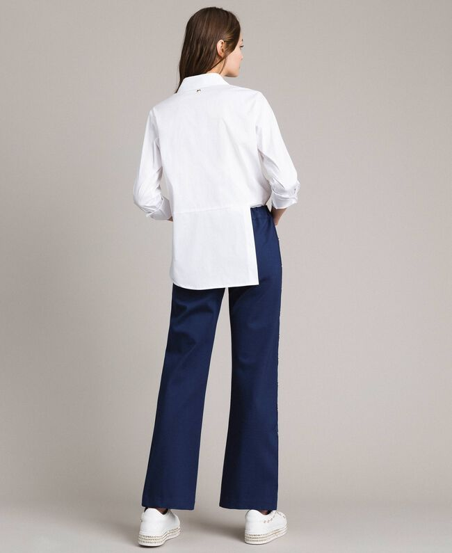 Drainpipe trousers with side slits and buttons Indigo Woman 191MP2155-03