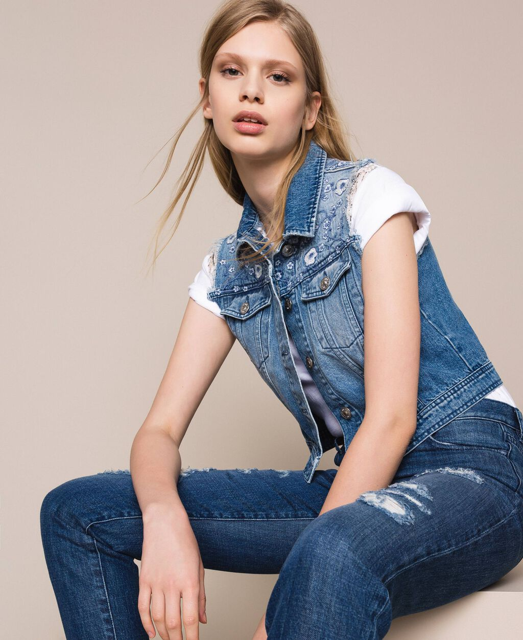 Denim waistcoat with floral embroidery