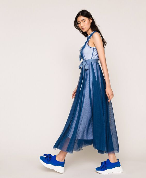 Full-length tulle gown with ruffle