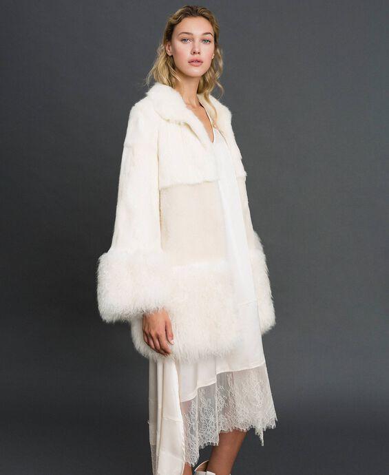 Manteau avec mélange de fourrures