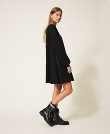 Kleid mit Nieten und Strass Schwarz Frau 202MT2152-04
