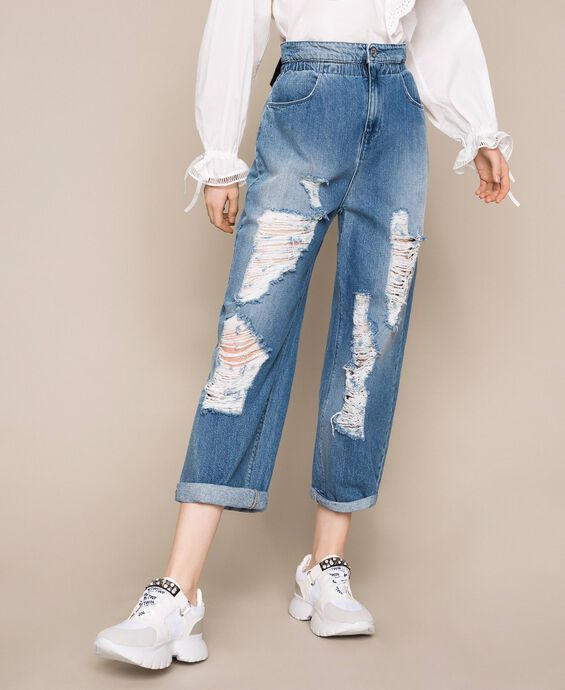 Loose fit jeans with rips