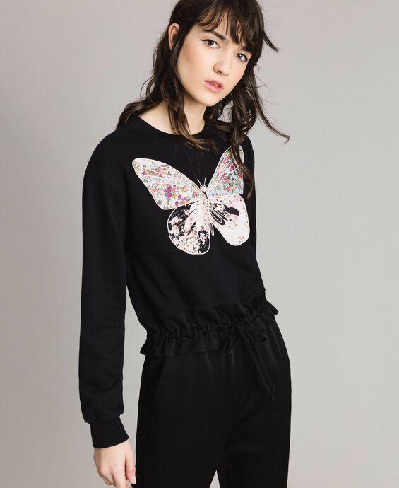 Sweat-shirt avec broderie papillon