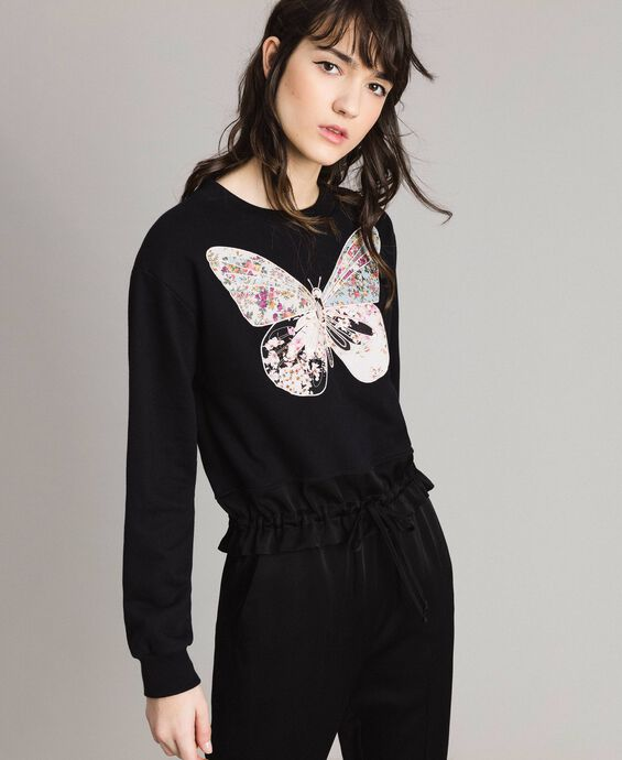Sweat-shirt avec broderie papillon