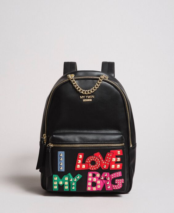 Faux leather backpack with patch and studs