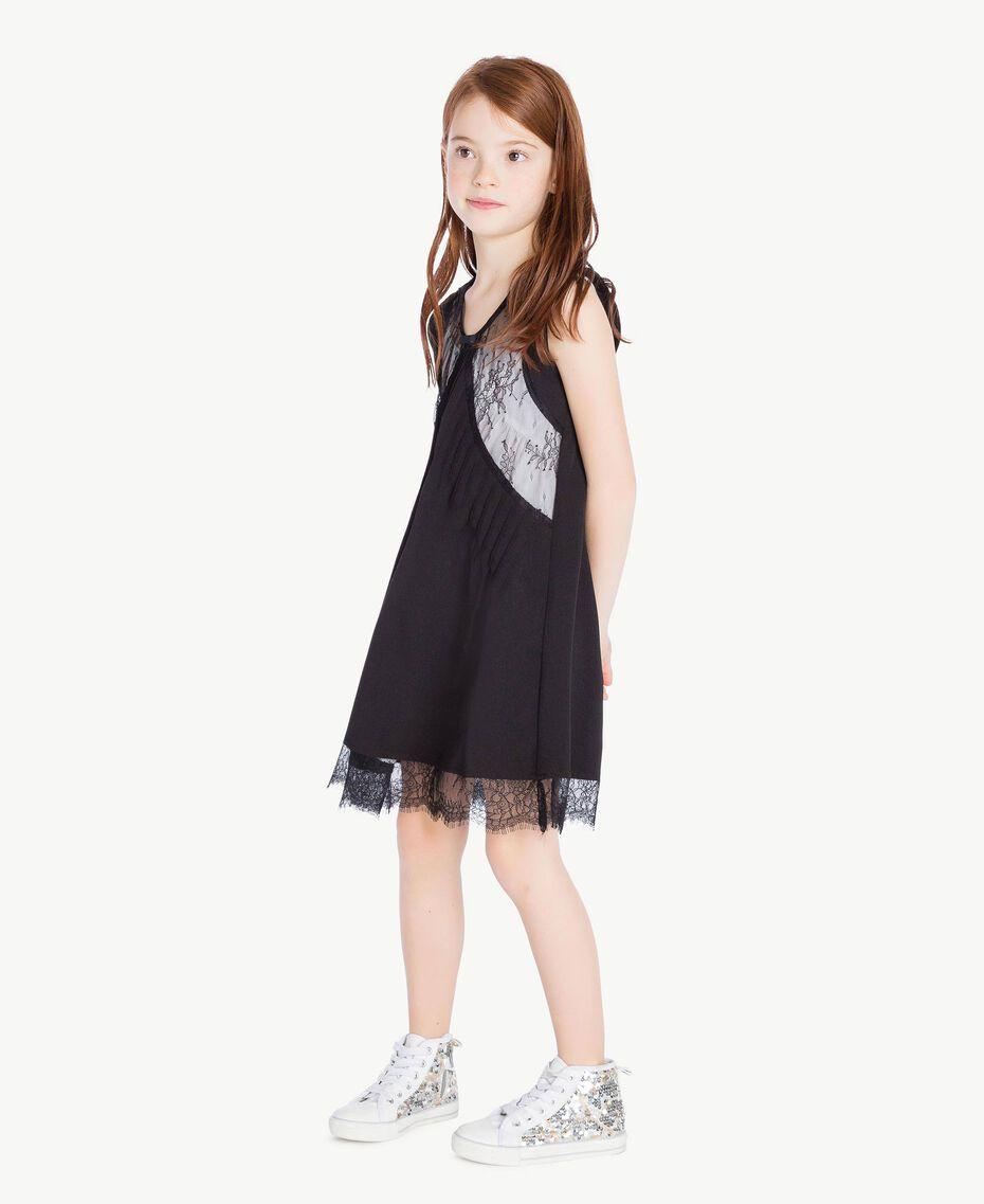 Kleid mit Spitze Zweifarbig Schwarz / Papyrusweiß Kind GS82EE-03