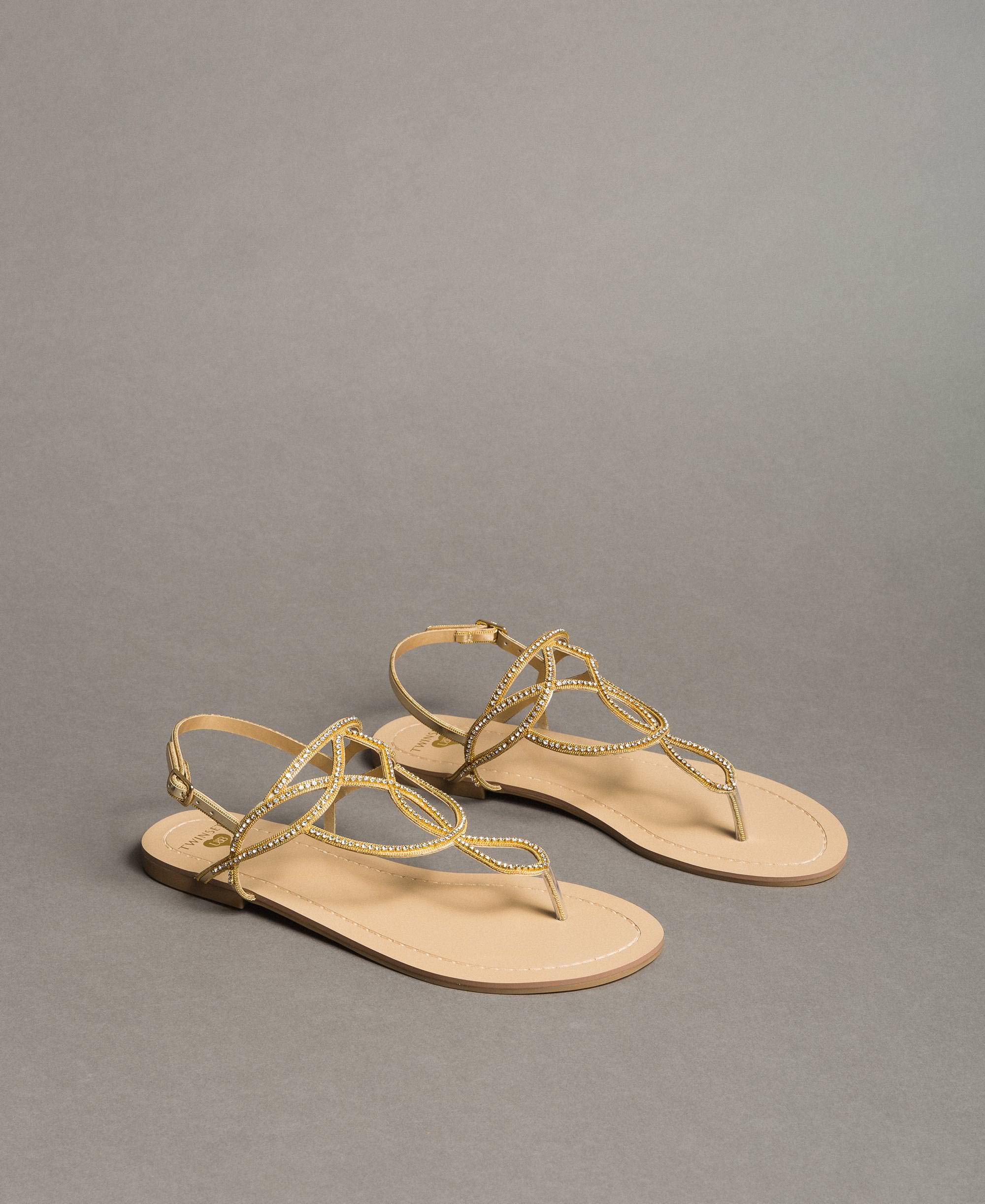 Flat thong sandals with rhinestones